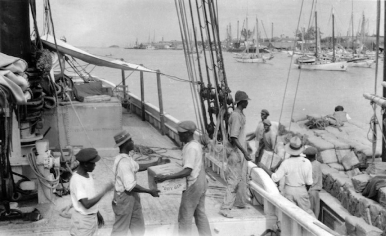 Workers loading spirits on to Bill's boat Arethusa in Nassau.